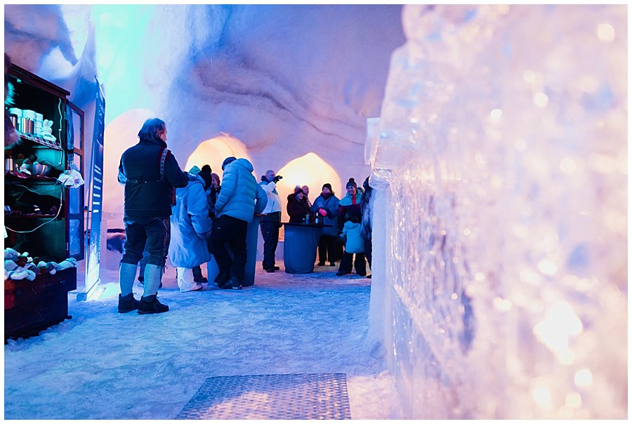 The guests stand around the ice bar as the accordion player plays traditional Austrian folk music
