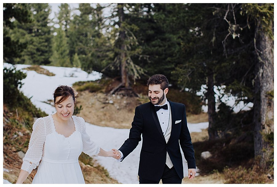 Susana leading Tiago through the snow and the forest in Austria
