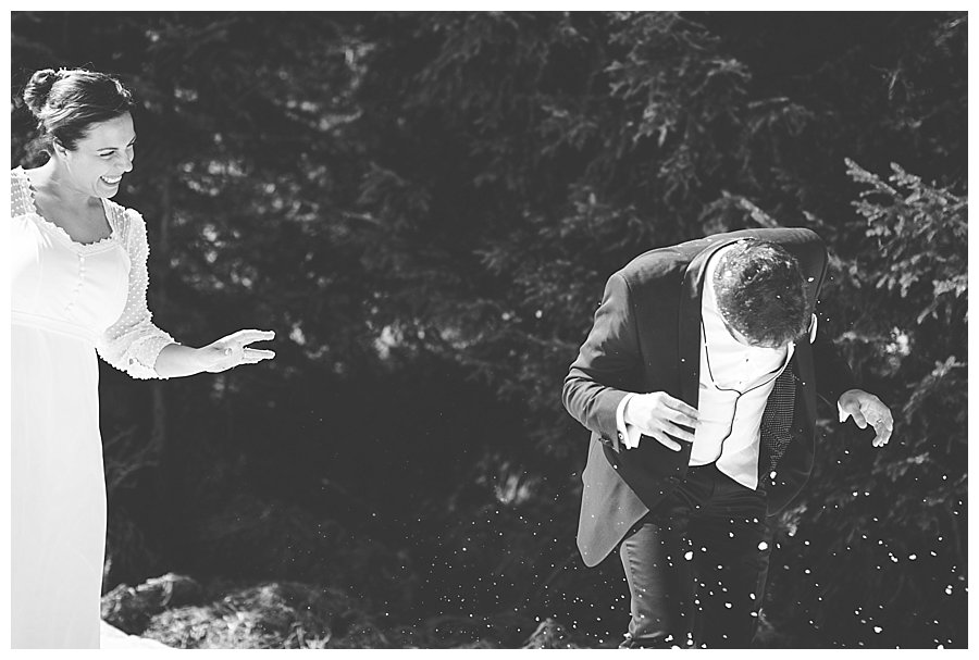 A snowball thrown by the bride hits the groom