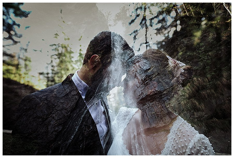 Double exposure photo of a bride and groom and a waterfall