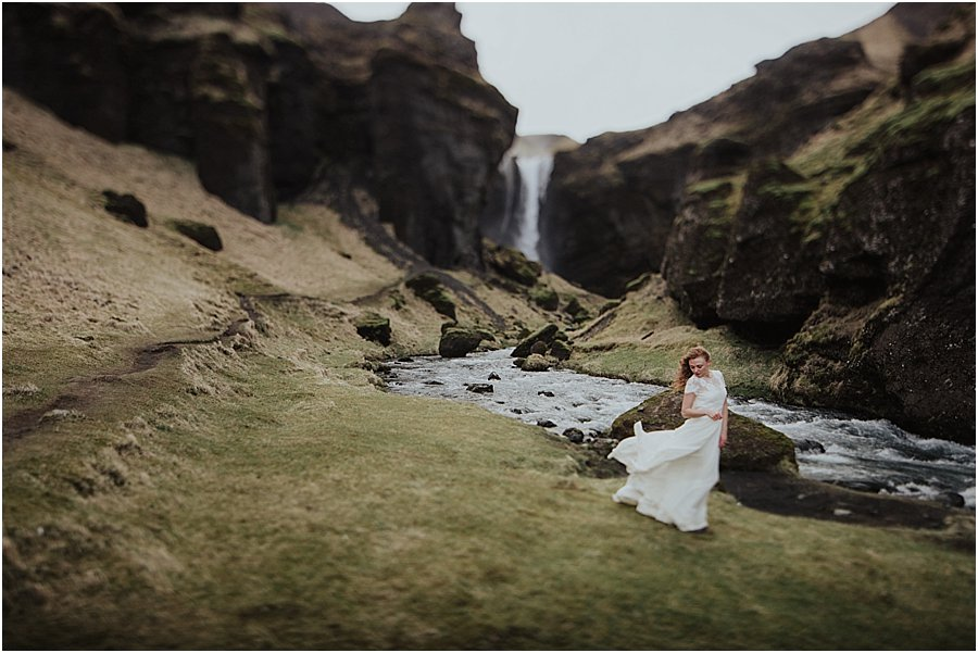 Icelandic Bride looking at her dress as it blows in the wind