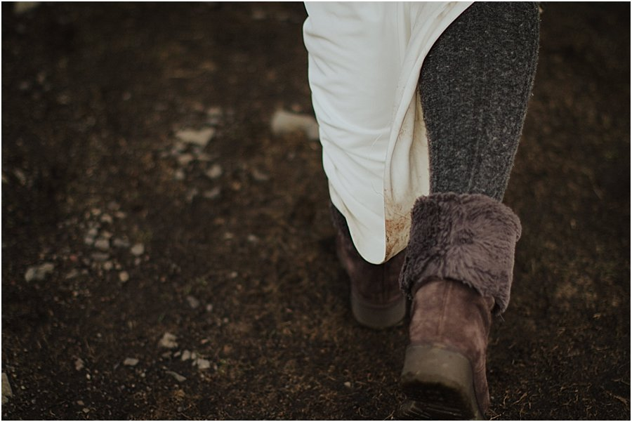 Picture of a bride's brown boots as she is walking