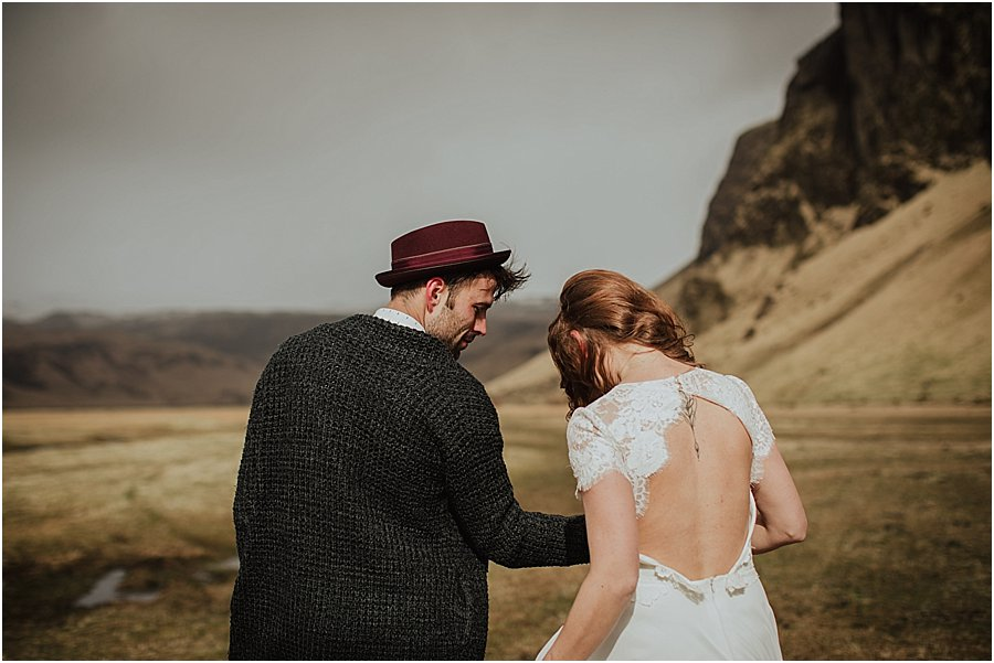 Bride and groom in a field in Iceland