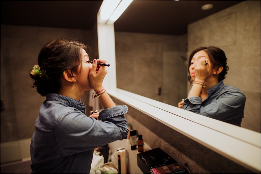 Kelly does her makeup in the bathroom of her hotel room in the Adlers hotel in Innsbruck by Wild Connections Photography