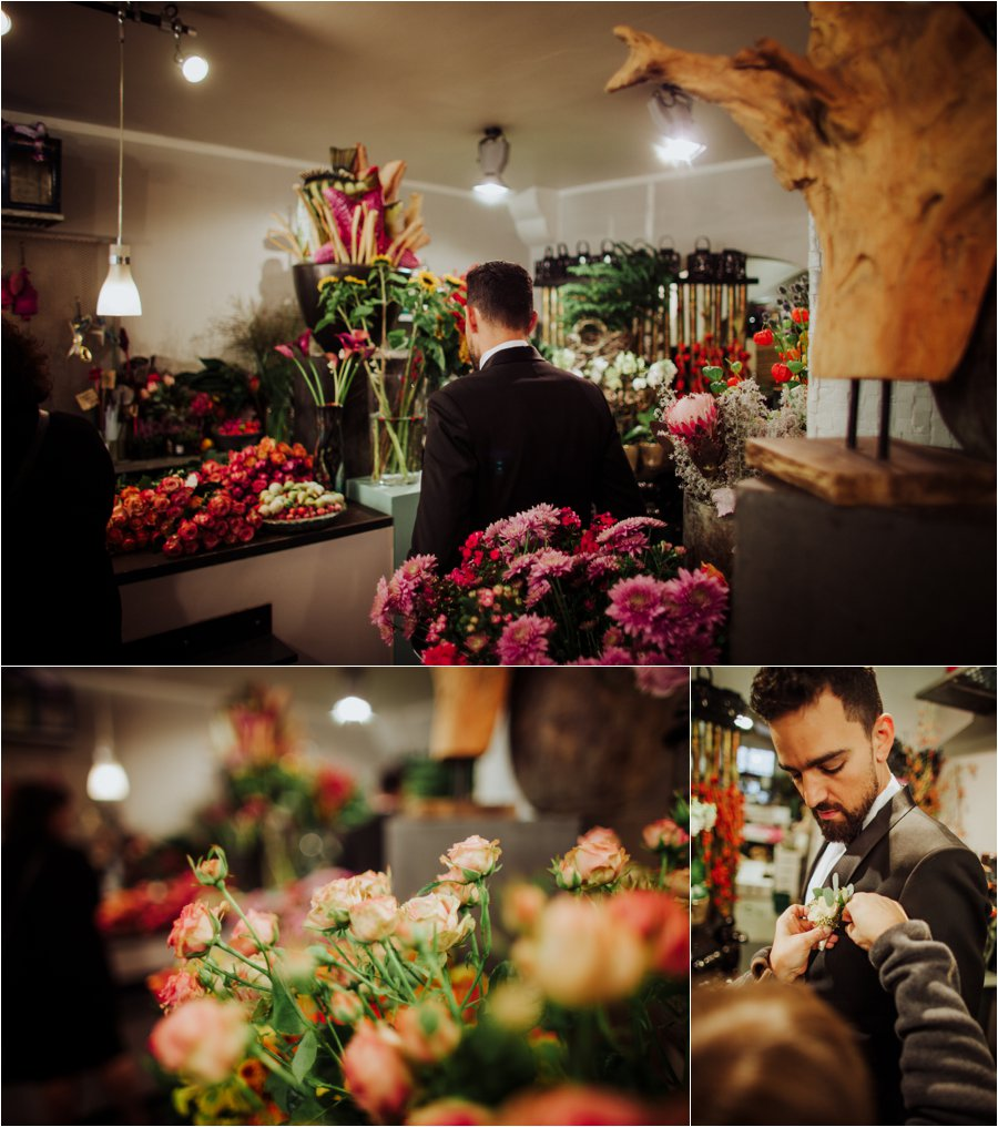 The groom Arik collects the bouquet from Blumen Hajny in Innsbruck by Wild Connections Photography