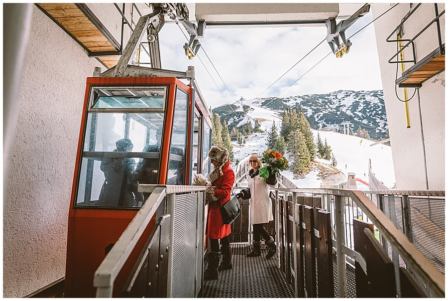 The wedding guests board the tiny vintage ski lift to the Rosshuette peak in Seefeld