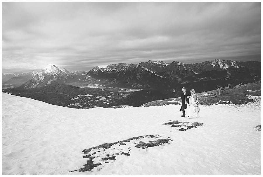 The father of the bride walks his daughter Steph up the ski slope to her ceremony