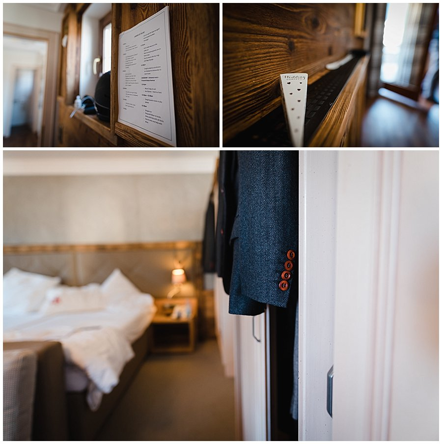 The groom's hotel room with his suit hanging on the wall and a to-do list taped to the wall