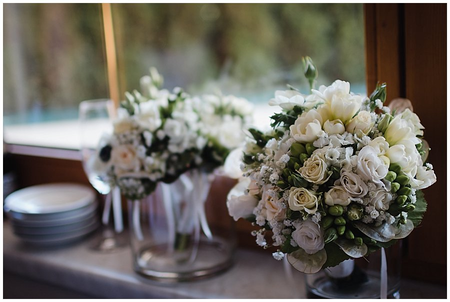 The bouquet sits on a vase on the windowsill