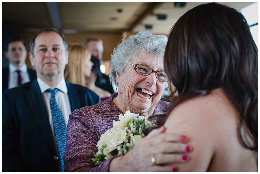 Bec's grandmother smiles as she congratulates her