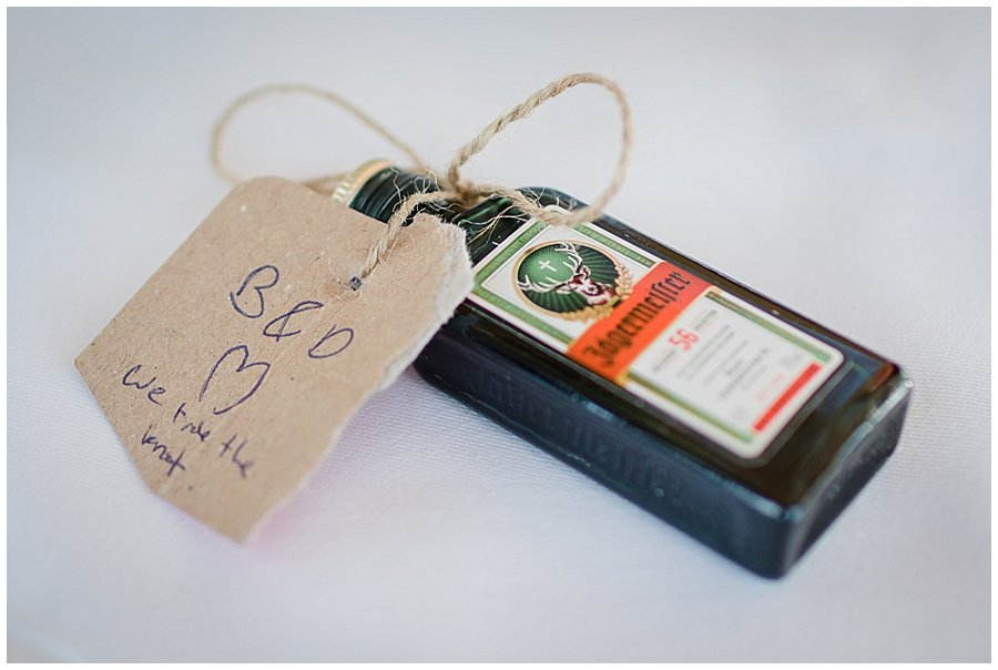 A small shot bottle of Jagermeister for the bride and groom