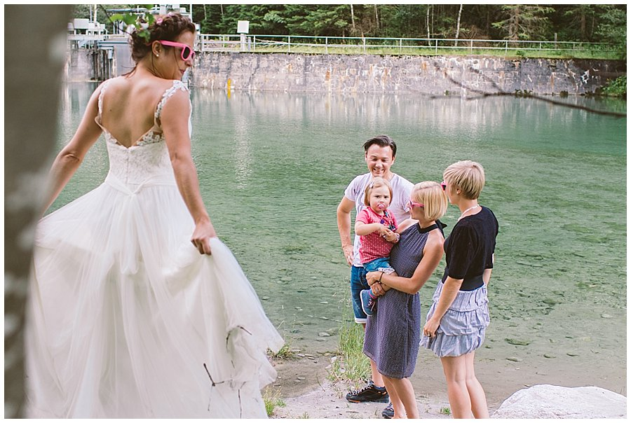 Bride in wedding dress and pink sunglasses
