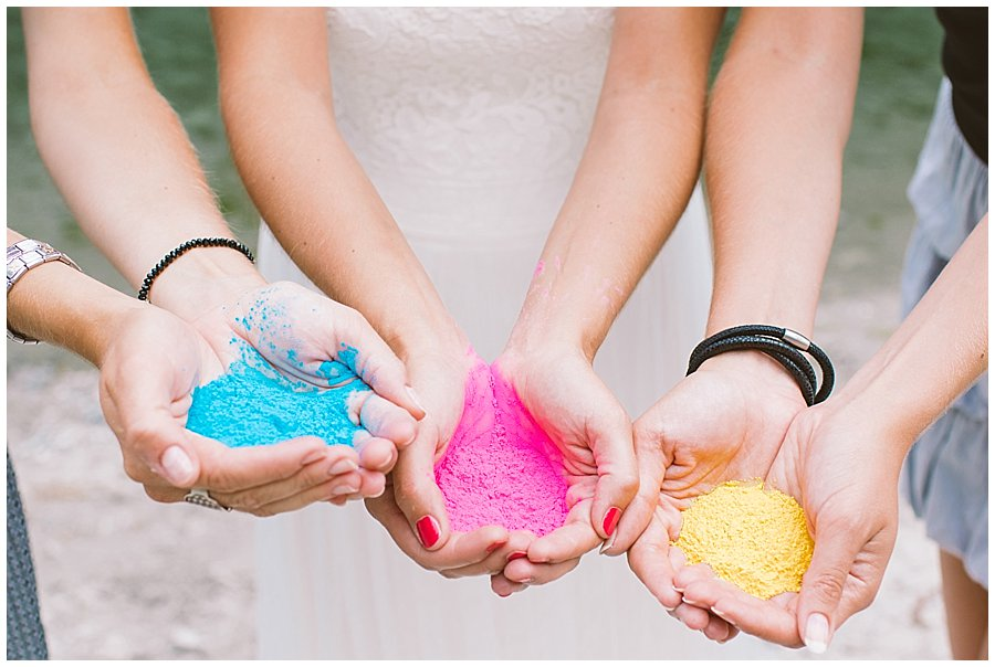 Close up of bride's hands with holi powder paint